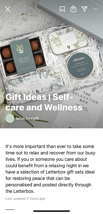 Image of a white gift box with bath bombs and other gifts