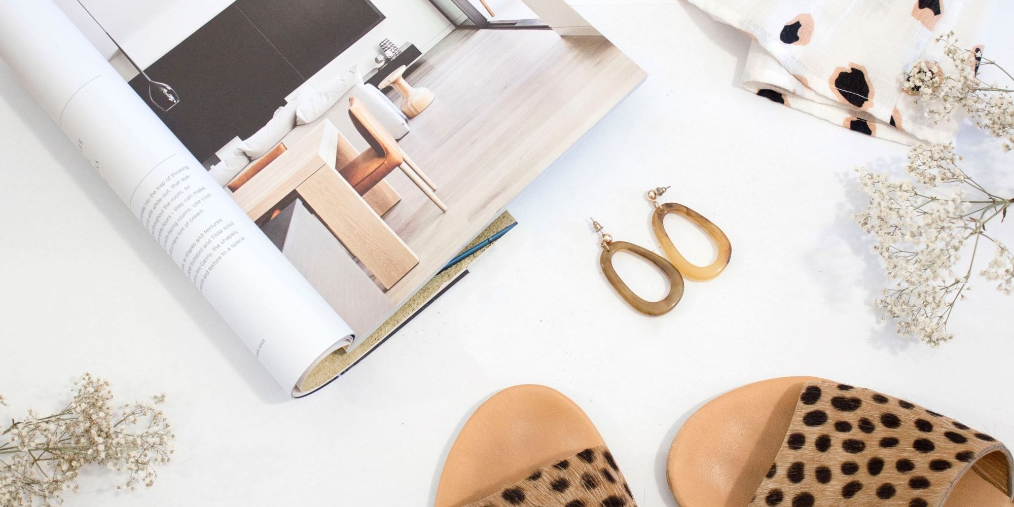 flat lay of magazine and accessories